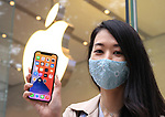 October 23, 2020, Tokyo, Japan - A customer displays her iPhone 12 as she purchased the new 5G iPhone at an Apple store in Tokyo on Friday, October 23, 2020. iPhone 12 and iPhone 12 Pro started to sell here while iPhone 12 Pro Max and iPhone 12 mini will go on sale next month.        (Photo by Yoshio Tsunoda/AFLO)