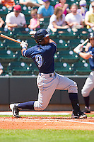 Jose Bonilla #9 of the Wilmington Blue Rocks follows through on his swing against the Winston-Salem Dash at BB&T Ballpark on April 24, 2011 in Winston-Salem, North Carolina.   Photo by Brian Westerholt / Four Seam Images