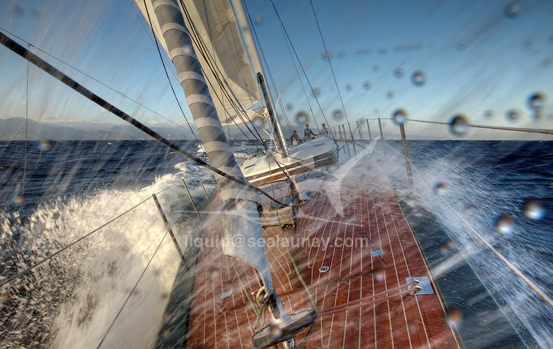 Nacira 67 designed by Axel de Beaufort and created/managed by SPRAY Yachting Management..The result is a wide planning hull shape equipped with a canting keel, twin rudder direction system and a 30 m high rotating mast.