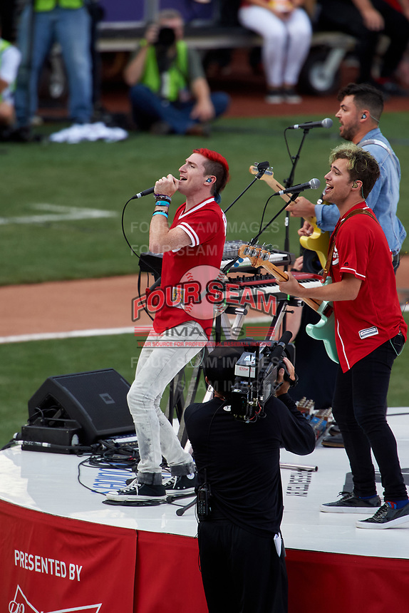 Cincinnati, Ohio based Walk the Moon - Nicholas Petricca (left), Eli Maiman (background), and Kevin Ray (foreground) - perform before the MLB Home Run Derby on July 13, 2015 at Great American Ball Park in Cincinnati, Ohio.  (Mike Janes/Four Seam Images)