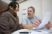 A resident speaks to Councillor Barrie Taylor at a regular Monday afternoon drop-in advice session at the Beethoven Centre, Queen's Park.