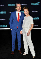 """LOS ANGELES, USA. December 11, 2019: Charles Randolph & Mili Avital at the premiere of """"Bombshell"""" at the Regency Village Theatre.<br /> Picture: Paul Smith/Featureflash"""