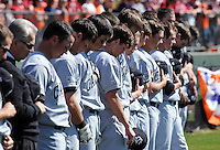 USC players pause for a moment of silence prior to a game between the Clemson Tigers and USC Gamecocks on March 2, 2008, at Doug Kingsmore Stadium in Clemson. Photo by: Tom Priddy/Four Seam Images