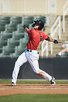 Travis Moniot (9) of the Kannapolis Intimidators follows through on his swing against the Delmarva Shorebirds at Kannapolis Intimidators Stadium on May 19, 2019 in Kannapolis, North Carolina. The Shorebirds defeated the Intimidators 9-3. (Brian Westerholt/Four Seam Images)