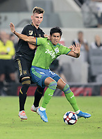 LOS ANGELES, CA - OCTOBER 29: Tristan Blackmon #27 of the Los Angeles FC attempts to defend against Xavier Arreaga #27 of the Seattle Sounders FC during a game between Seattle Sounders FC and Los Angeles FC at Banc of California Stadium on October 29, 2019 in Los Angeles, California.