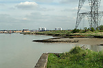 Swanscombe Peninsula site of the £2billion amusement theme park. Looking across the River Thames to Tilbury new housing and tower blocks of flats.2014