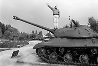 Russia. Krasnodar Krai Region. Krasnodar. Igor Popov is a new millionaire who made his money at the fall of USSR (CCCP). He stands on a T-34 tank in a memorial dedicated to World War II. He raises his right arm and jokes about Russian communist history. The T-34 is a Soviet medium tank introduced in 1940, famously deployed with the Red Army during World War II (the Second World War, often abbreviated as WWII or WW2). The T-34 was the mainstay of Soviet armoured forces throughout the war. Krasnodar (also known as Kuban) is the largest city and the administrative centre of Krasnodar Krai in Southern Russia. 20.09.1993 © 1993 Didier Ruef