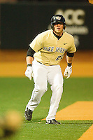 James Harris #22 of the Wake Forest Demon Deacons takes his lead off of third base against the Northwestern Wildcats at Gene Hooks Field on February 26, 2011 in Winston-Salem, North Carolina.  Photo by Brian Westerholt / Four Seam Images