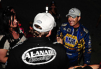 Oct. 30, 2011; Las Vegas, NV, USA: NHRA top fuel dragster driver Del Worsham (left) celebrates with funny car winner Ron Capps after winning the Big O Tires Nationals at The Strip at Las Vegas Motor Speedway. Mandatory Credit: Mark J. Rebilas-