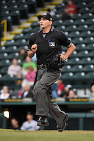Home plate umpire Joe George gets into position during a game between the Jupiter Hammerheads and Bradenton Marauders on April 19, 2014 at McKechnie Field in Bradenton, Florida.  Bradenton defeated Jupiter 4-0.  (Mike Janes/Four Seam Images)