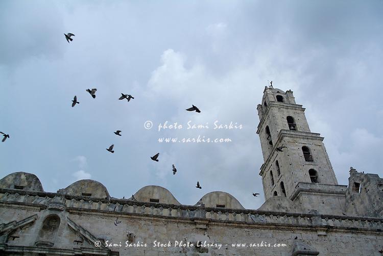 Birds flying above the basilica and the monastery of Saint Francis of Assisi (Basilica Menor de San Francisco de Asis) in Havana, Cuba.