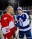 31 December 2013: Former Detroit Red Wing Mickey Redmond, left, talks with Former Toronto Maple Leafs forward Lanny McDonald (7) during the Toronto Maple Leafs v Detroit Red Wings Alumni Showdown hockey game, at Comerica Park, in Detroit, MI.