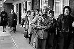 Women watch a funeral Hoxton east London UK 1978