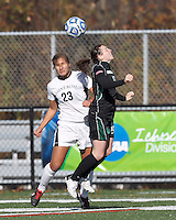 College of St Rose forward Michaela Phillips (23) and Wilmington University midfielder Jordanne Hoesli-Atkins (16) battle for head ball.. In 2012 NCAA Division II Women's Soccer Championship Tournament First Round, College of St Rose (white) defeated Wilmington University (black), 3-0, on Ronald J. Abdow Field at American International College on November 9, 2012.