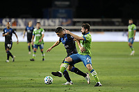 SAN JOSE, CA - OCTOBER 18: Cristian Espinoza #10 of the San Jose Earthquakes is defended by Joao Paulo #6 of the Seattle Sounders during a game between Seattle Sounders FC and San Jose Earthquakes at Earthquakes Stadium on October 18, 2020 in San Jose, California.