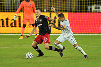 WASHINGTON, DC - SEPTEMBER 27: Frederic Brilliant #13 of D.C. United battles for the ball with Gustavo Bou #7 of New England Revolution during a game between New England Revolution and D.C. United at Audi Field on September 27, 2020 in Washington, DC.