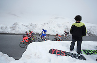 riders stepping on other men's territory riding up the snow-covered Colle dell'Agnello (2744m)<br /> <br /> stage 19: Pinerolo(IT) - Risoul(FR) 162km<br /> 99th Giro d'Italia 2016