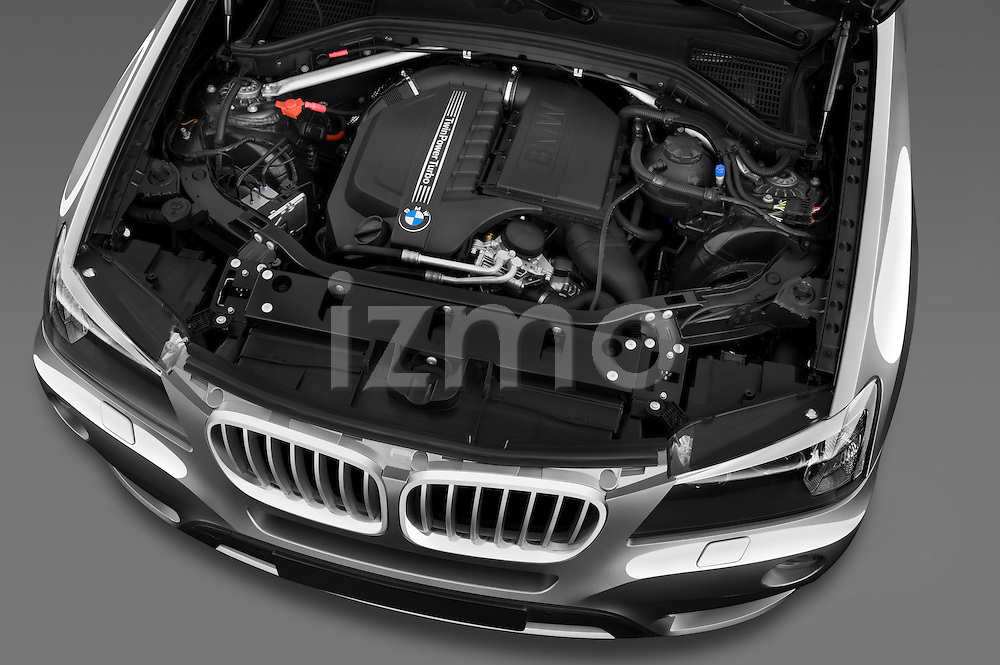 High angle engine detail of a 2011 BMW x3 xDrive35i SUV