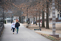 Erin Enmark (left) and Peyton Mosman walk back to their sorority house after going to the gym Monday Jan. 11, 2021 at the University of Arkansas campus in Fayetteville. Monday was the first day back to classes after the holiday break. Visit nwaonline.com/210112Daily/ and nwadg.com/photos. (NWA Democrat-Gazette/J.T. Wampler