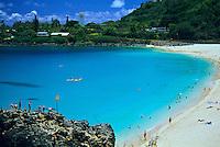 Calm summer waters at the beach at Waimea Bay on the north shore of Oahu, Hawaii