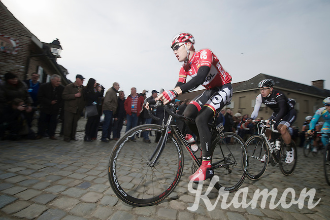 Pim Ligthart (NLD/Lotto-Belisol) over the cobbles of the Oude Kwaremont<br /> <br /> Dwars Door Vlaanderen 2014