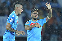 NAPLES, Italy - September 18, 2013: Napoli beats Borussia Dortmund 2-1 during the Champions League match in San Paolo Stadium. In the photo the celebration for the 2-0 goal scored by Insigne