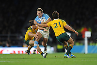 Tomas Lavanini of Argentina is sandwiched between Matt Toomua and Nick Phipps of Australia during the Semi Final of the Rugby World Cup 2015 between Argentina and Australia - 25/10/2015 - Twickenham Stadium, London<br /> Mandatory Credit: Rob Munro/Stewart Communications
