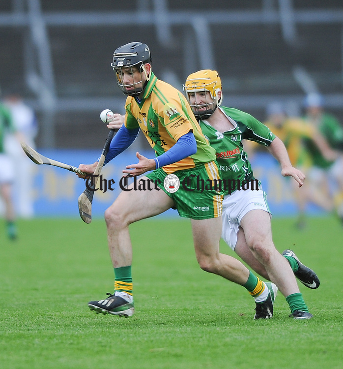 Patrick Donnellan of O Callaghan's Mills in action against Ross Horan of Scariff during their game in Cusack Park. Photograph by John Kelly.