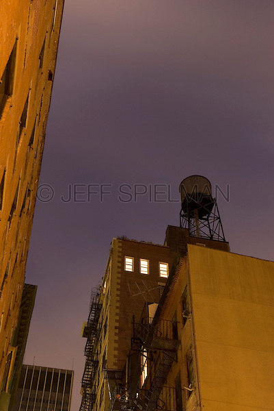 AVAILABLE FROM PLAINPICTURE FOR COMMERCIAL AND EDITORIAL LICENSING.  Please go to www.plainpicture.com and search for image # p5690220.<br /> <br /> Upward View of Windows Illuminated at Night in Lower Manhattan, New York City, New York State, USA