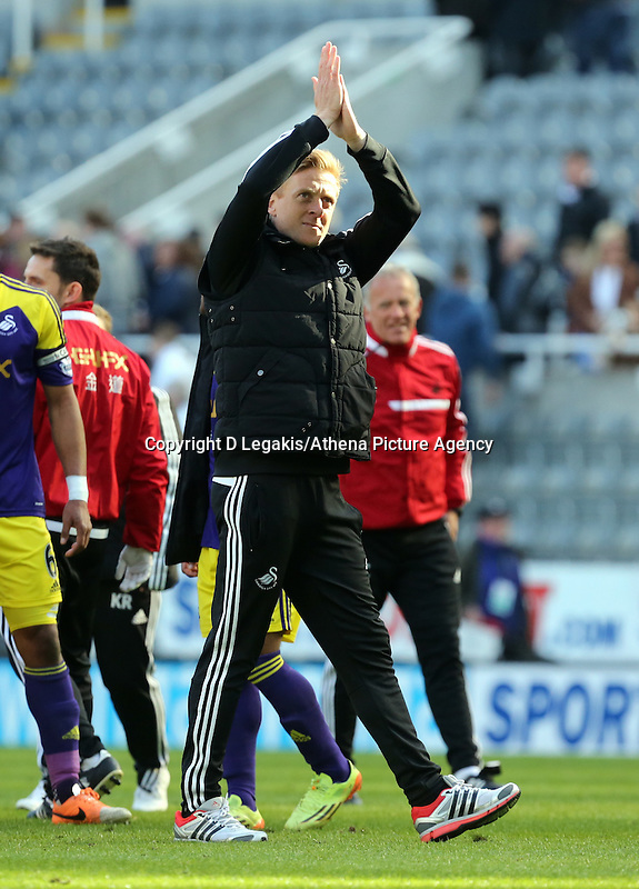 Pictured: Swansea head coach Garry Monk takes to the pitch to thank away supporters after the final whistle. Saturday 19 April 2014<br /> Re: Barclay's Premier League, Newcastle United v Swansea City FC at St James Park, Newcastle, UK.