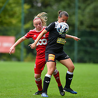 Zoe Van Eynde (14) of Standard  and Ulrike De Frere (31) of Eendracht Aalst in action during a female soccer game between Standard Femina de Liege and Eendracht Aalst dames on the fourth matchday in the 2021 - 2022 season of the Belgian Scooore Womens Super League , Saturday 11 th of September 2021  in Angleur , Belgium . PHOTO SPORTPIX | BERNARD GILLET