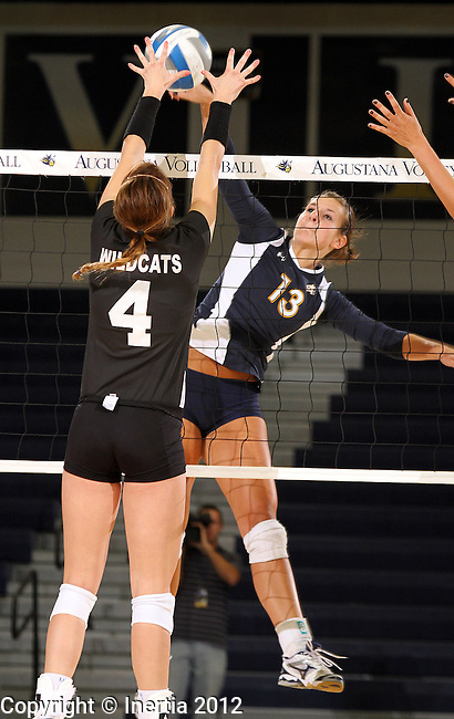 SIOUX FALLS, SD - SEPTEMBER 18:  Taylor Hrdlichka #13 from Augustana battles for the ball with Cori Hobbs #4 from Wayne State in the first match of their game Tuesday night at Augustana. (Photo by Dave Eggen/Inertia)