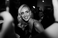 """VENICE, ITALY - SEPTEMBER 04: Chiara Ferragni signs autographs and takes selfies with fans on the red carpet ahead of the """"Chiara Ferragni - Unposted"""" screening during the 76th Venice Film Festival at Sala Giardino on September 04, 2019 in Venice, Italy."""