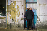 © Joel Goodman - 07973 332324 . Manchester , UK . 05/04/2015 . A man kisses a woman in a doorway on Dantzic Street in Manchester City Centre . Revellers on a Saturday night out during the Easter Bank Holiday weekend . Photo credit : Joel Goodman