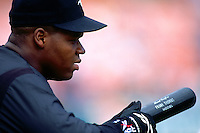 OAKLAND, CA - Frank Thomas of the Chicago White Sox takes batting practice before a game against the Oakland Athletics at the Oakland Coliseum in Oakland, California on August 10, 1994. Photo by Brad Mangin