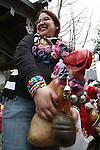 Apr 04, 2010 - Kawasaki, Japan - A visitor holds a wooden phallic figure during the Kanamara Matsuri (Festival of the Steel Phallus) held in Wakamiya Hachimangu Shrine on April 4, 2010 in Kawasaki, Japan. The annual feritility festival, held traditionally the first Sunday in April, is said to encourage fertility and bring harmony to married couples. The festival has also become somewhat of a tourist attraction and is used to raise money for HIV research and awareness of AIDS prevention.