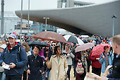Crowds enter the London 2012 Olympic Park for the official opening of the Olympic Stadium.