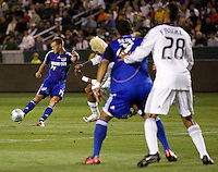 Kansas City Wizards midfielder Jack Jewsbury (14) sends a ball up field as teammate Scott Sealy (19) and LA Galaxy defender Sean Franklin (28) look on during a MLS match. The LA Galaxy defeated the Kansas City Wizards 3-1 at Home Depot Center stadium in Carson, Calif., on Saturday, May 24, 2008.