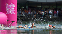 09 AUG 2012 - LONDON, GBR - Competitors round a turn buoy during the London 2012 Olympic Games women's 10km Marathon Swimming in Hyde Park, London, Great Britain .(PHOTO (C) 2012 NIGEL FARROW)
