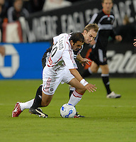 Chicago Fire midfielder Cuauhtemoc Blanco (10) being fouled by DC United defender Bryan Namoff (26). D. C. United tied the Chicago Fire 2-2 during the second leg of the MLS Eastern Conference Semifinals at RFK Stadium in Washington, DC, on November 1, 2007. The Chicago Fire advance to the Eastern Conference Finals after beating DC United 3-2 on aggregate.
