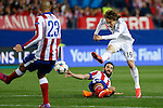 Atletico de Madrid's Arda Turan (L) and Real Madrid´s Luka Modric during quarterfinal first leg Champions League soccer match at Vicente Calderon stadium in Madrid, Spain. April 14, 2015. (ALTERPHOTOS/Victor Blanco)