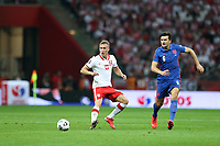 8th September 2021; PGE National Stadium, Warsaw, Poland: FIFA World Cup 2022 Football qualification, Poland versus England;  ADAM BUKSA outpaced by the move from HARRY MAGUIRE