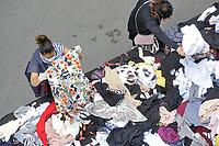 - Milan, street market, used clothes stall <br /> <br /> - Milano, mercato rionale, bancarella di abiti usati