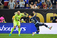Houston, TX - Tuesday June 21, 2016: Brad Guzan, Ezequiel Lavezzi during a Copa America Centenario semifinal match between United States (USA) and Argentina (ARG) at NRG Stadium.