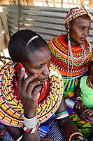 KENYA, Marsabit, Samburu village Merille, Rapunye Ntumo a women self help group, woman with cellular phone / KENIA, Marsabit, Samburu Dorf Merille, Rapunye Ntumo Frauen Selbsthilfegruppe