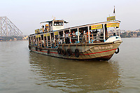 A passenger boat cruises along the Ganges River in Kolkata.<br /> <br /> To license this image, please contact the National Geographic Creative Collection:<br /> <br /> Image ID: 1925781 <br />  <br /> Email: natgeocreative@ngs.org<br /> <br /> Telephone: 202 857 7537 / Toll Free 800 434 2244<br /> <br /> National Geographic Creative<br /> 1145 17th St NW, Washington DC 20036
