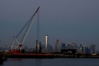 BAYONNE, NEW JERSEY - MARCH 03: Port cranes, World Trade Center and Lower Manhattan are seen from Port Bayonne on March 03, 2021 in Bayonne, New Jersey. According projections the EE.UU economy rises 5,5% in 2021. where the excess savings in North American households will return to the market after vaccination and boosting consumption. (Photo by VIEWpress)