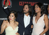 """HOLLYWOOD, LOS ANGELES, CA, USA - MARCH 20: America Ferrera, Diego Luna, Rosario Dawson at the Los Angeles Premiere Of Pantelion Films And Participant Media's """"Cesar Chavez"""" held at TCL Chinese Theatre on March 20, 2014 in Hollywood, Los Angeles, California, United States. (Photo by Celebrity Monitor)"""