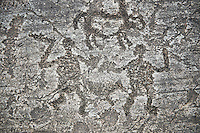 Prehistoric Petroglyph, rock carving, of two men fighting with swords and small shield carved by the Camunni people in the ,iddle to late iron age between  900-1200 BC, Rock no 18, Seradina II area , Seradina-Bedolina Archaeological Park, Valle Comenica, Lombardy, Italy