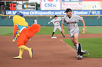 The Famous San Diego Chicken pulls down the pants of an actor playing the part of the third baseman for an on field promotion during a game between the Indianapolis Indians and Rochester Red Wings on July 26, 2014 at Frontier Field in Rochester, New  York.  Rochester defeated Indianapolis 1-0.  (Mike Janes/Four Seam Images)